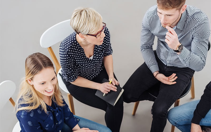 Gruppe im Coaching zur Teilhabe am Arbeitsmarkt